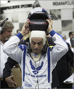 Brazil's Raphael Matos pulls off his helmet after he qualified Sunday for the Indianapolis 500.