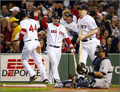 Boston's Jason Bay is congratulated by teammate Jeff Bailey after scoring the Red Sox's first run of the game in the second inning.