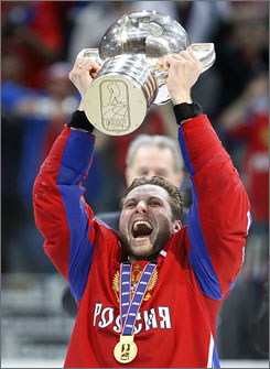 Russian captain Alexei Morozov lifts the championship trophy after his squad defeated Canada  for the hockey world championship for the second straight year.