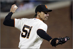 The Giants' Randy Johnson, pitching to the Washington Nationals, struck out nine en route to his 298th career win.
