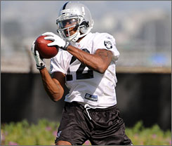 Darrius Heyward-Bey catches a pass during Raiders practice on Friday. Oakland's first-round draft pick sat out Sunday's practice due to a sore hamstring and fatigue.