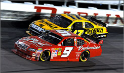 Kasey Kahne (9) races alongside Matt Kenseth at Darlington Raceway on his way to a 23rd-place finish. Kahne hopes to get the full benefit out of a new Dodge engine that debuts this weekend.