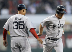 The Red Sox's J.D. Drew, right, shakes hands with third base coach DeMarlo Hale after hitting a solo home run against the Angels in the second inning.