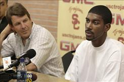 Former Southern California basketball player O.J. Mayo, right, speaks to reporters during an Aug. 28, 2007 news conference as coach Tim Floyd listens. Louis Johnson, a former associate of Mayo, who is now in the NBA, told Yahoo! Sports that Floyd paid to help get Mayo to play for the Trojans.