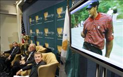 PGA Tour Commissioner Tim Finchem, right, accompanied by President's Cup team captains Greg Norman, center, and Fred Couples, watch at video during a news conference at the National Press Club in Washington on Wednesday.