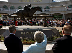 "Trainer Michael Matz, left, and owners Gretchen and Roy Jackson view a statue of Barbaro outside Churchill Downs in April. ""For some reason, he just captured the interest of the public,"" Roy Jackson said of the late Thoroughbred."