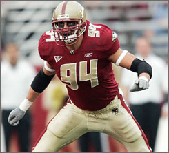Mark Herzlich stayed at  Boston College after  winning the ACC's defensive player of the year award as a junior.