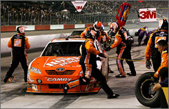 Joey Logano comes to a halt for late-race pit service from his Joe Gibbs Racing crew at Darlington Raceway.