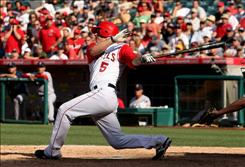Jeff Mathis of the Los Angeles Angels knocks in the winning run in the 12th inning against the Boston Red Sox at Angel Stadium in Anaheim, Calif. The Angels won 5-4.