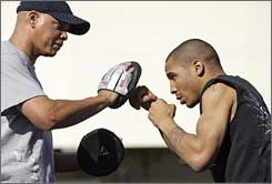 Andre Ward, right, shadow-boxes with trainer Virgil Hunter.