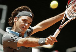Roger Federer kept up his dominance over Andy Roddick, defeating the American in their first match on clay to reach the semifinals at the Madrid Open.