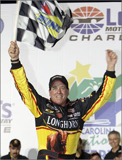 Ron Hornaday Jr. celebrates in victory lane after earning the 40th trucks victory of his career. The win also helped Hornaday leapfrog Mike Skinner for the trucks point lead.