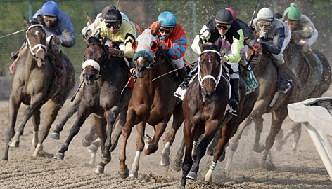 Jockey Terry Thompson and Payton d'Oro, front right, lead the field en route to winning the Black-Eyed Susan Stakes.