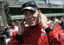 Driver Robert Doornbos smiles after he qualified for the Indianapolis 500 on the third day of qualifications Saturday. Doornbos grabbed the 23rd position in the lineup.