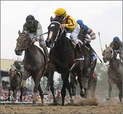 Rachel Alexandra, center, stays ahead of Mine That Bird, left, to win the Preakness Stakes.
