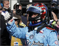 John Andretti celebrates after bumping himself into the field in the closing minutes on the final day of qualifications for the Indianapolis 500.