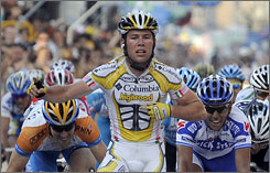Great Britain's Mark Cavendish gestures as he crosses the finish line and wins the ninth stage of 92nd Giro of Italy.