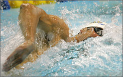 Michael Phelps cuts through the water in the 100-meter preliminaries in Charlotte.