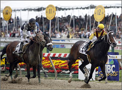 Jockey Calvin Borel celebrates after riding Rachel Alexandra, right, to victory in the Preakness ahead of Kentucky Derby winner Mine That Bird.