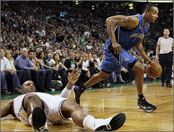 Magic forward Rashard Lewis drives past a fallen Glen Davis in the second quarter of Orlando's Game 7 win.