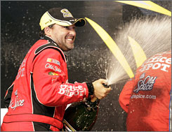 Tony Stewart celebrates in victory lane after winning the NASCAR Sprint Cup All-Star Race Saturday night at Lowe's Motor Speedway.