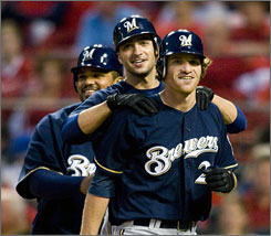 Brewers third baseman Mat Gamel, right, is congratulated by left fielder Ryan Braun, center, and first baseman Prince Fielder after hitting a three run home run in the third inning.