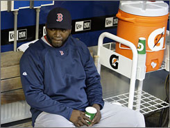 The Red Sox's David Ortiz, left, sitting on the bench during a game against the Mariners on May 15, has yet to hit a home run this season.