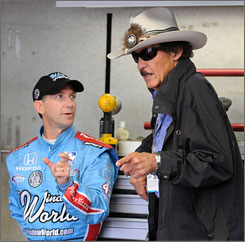 John Andretti, left, and team owner Richard Petty discuss their car's performance May 9 in the garage at Indianapolis Motor Speedway.