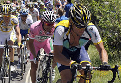 Lance Armstrong rides in front of Danilo Di Luca, who wears the overall leader's pink jersey during the Giro's 10th stage.