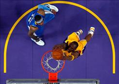 Los Angeles Lakers forward Kobe Bryant, right, dunks the ball in front of Carmelo Anthony of the Denver Nuggets in Game 1 of the Western Conference Finals at Staples Center in Los Angeles. Bryant scored 40 while Anthony scored 39 as the Lakers defeated the Nuggets 105-103.