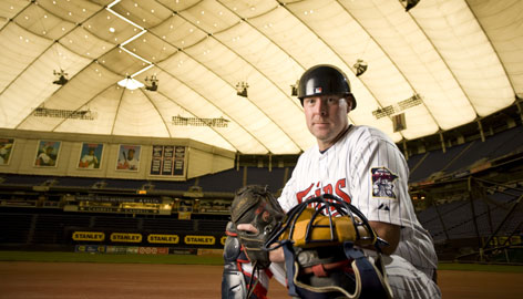 Twins backup catcher Mike Redmond knows his job is to be available so the starter, All-Star Joe Mauer, can get some time off when he needs it.