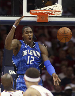The Magic's Dwight Howard, scoring on a lob during the fourth quarter, had 30 points to help Orlando steal Game 1.