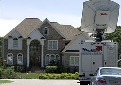 A satellite TV truck awaits the arrival of Michael Vick in front of his Hampton, Va., home.