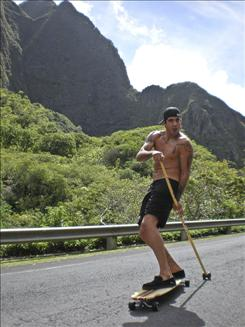 MMA Fighter and Kahuna Rider Kendall Grove land paddles in his native Maui.