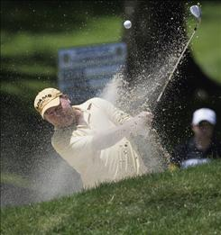 Scott Hoch hits out of a sand trap on the 17th hole Thursday during the first round of the 70th Senior PGA Championship at the Canterbury Golf Club in Beachwood, Ohio. Hoch finished the round at 4-under par 66 to share the lead.with Tom Purtzer.