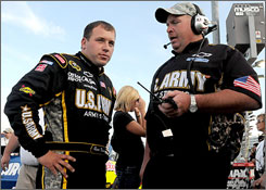 Ryan Newman talks over his pole-winning lap with his crew after setting the pace in qualifying at Lowe's Motor Speedway.