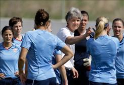 "Pia Sundhage, center, head coach of the United States women's soccer team, wants to ""change the environment of the team a little bit."""