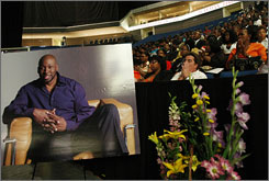 A portrait of former NBA great and jazz musician Wayman Tisdale is displayed at his funeral in Tulsa.