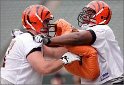 The Bengals added first-round draft pick Andre Smith, right, to help protect QB Carson Palmer.
