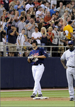 The Twins' Michael Cuddyer gets a standing ovation after hitting for the cycle against the Brewers in Minneapolis.