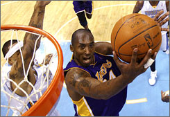 Lakers guard Kobe Bryant drives past the Nuggets' Kenyon Martin on his way to scoring a game-high 41 points.