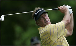 Michael Allen watches a shot on the second hole during the final round of the Senior PGA Championship. Allen held off Larry Mize to win the event in his debut on the Champions Tour.