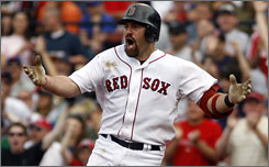 Boston's Kevin Youkilis reacts to dispute what he thought was a home-run ball that was ruled foul in the fifth inning.