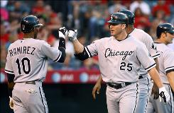 Jim Thome, right, is congratulated by Alexei Ramirez after hitting a three-run home run in the third inning, passing Mike Schmidt for 13th place on the career home run list. Thome's Chicago White Sox rolled over the Los Angeles Angels 17-3.