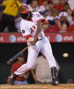 Los Angeles Angels outfielder Vladimir Guerrero, shown here hitting an RBI single against the Oakland Athletics on April 6, was activated from the disabled list on Monday.