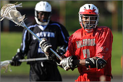 Peete, right, led Baltimore's Walbrook High School with 36 goals and 25 assists this year.