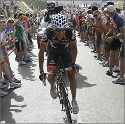 Carlos Sastre climbs through the crowd of spectators to his win in Stage 16 of the Giro d'Italia.