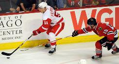 Detroit Red Wings center Valtteri Filppula, left, shown in Game 4 of the Western Conference finals, has helped spark the Red Wings' attack with 12 assists in the playoffs.