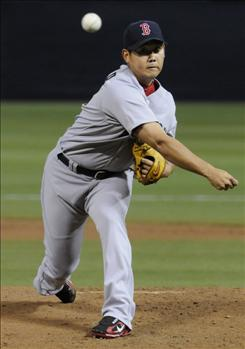 Boston Red Sox pitcher Daisuke Matsuzaka tied a franchise record set 80 years ago with four wild pitches as the Red Sox tied a modern-day record by throwing six wild pitches against the Minnesota Twins in Wednesday night's 4-2 loss. It was just the fifth time since 1900 that a team threw six wild pitches in a game.