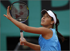 Ana Ivanovic is trying to regain her championship form in her return to the site of her only Slam title in last year's French Open. The 21-year-old Serb beat Tamarine Tanasugarn in straight sets Wednesday to reach the third round.